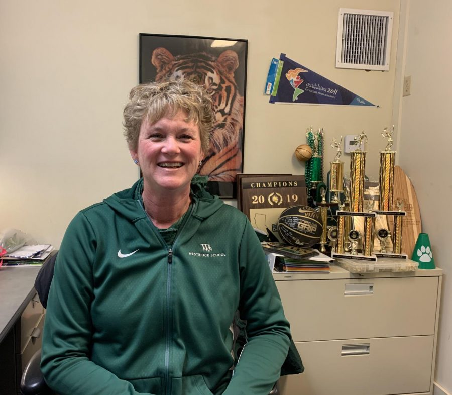 Coach Horn in her office full of athletic trophies
