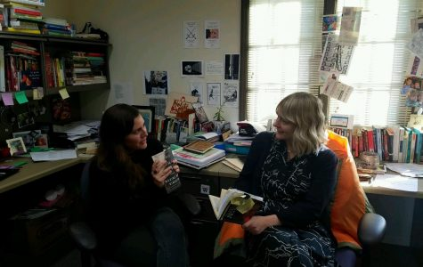Ms. Stevenson (left) and Ms. Yurcak (right) discuss their favorite books.