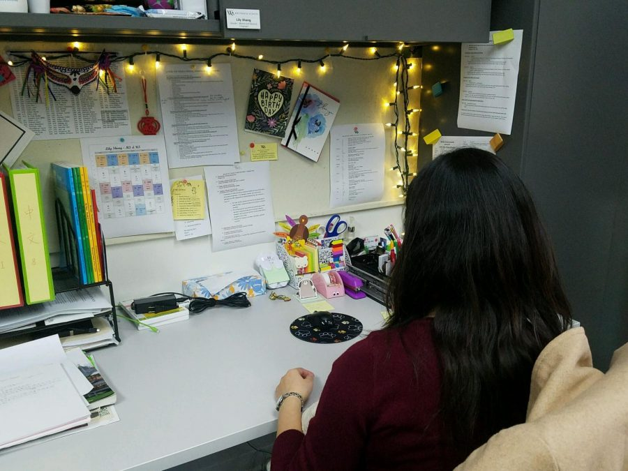 "Ms. Shang organizes her desk before starting her work. ""A good office environment is not how we're having fun all the time, it's how we really respect each other and how we support each other,"" shared Ms. Shang"