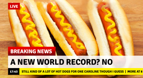 "A fake news screenshot with the headline ""A New World Record? No"" and the ticker saying ""Still kind of a lot of hot dogs for one caroline though."" The background photo is three hot dogs."