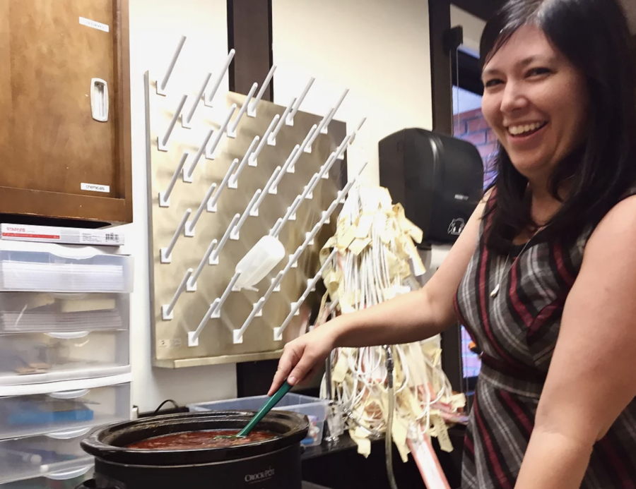 Barbara Chabot stirs her Chili pot as the competition heightens.