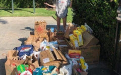 Mia G. '25 standing in front of piles of donated breakfast cereal