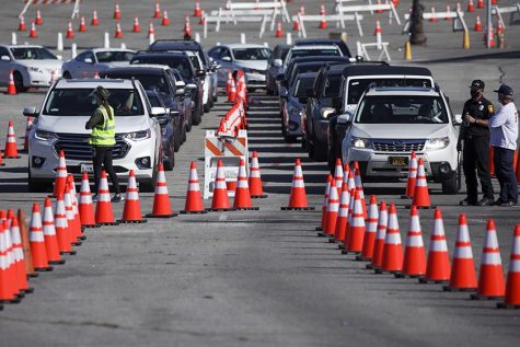 Cars line up at Dodger Stadium to receive doses of the Covid-19 vaccination.