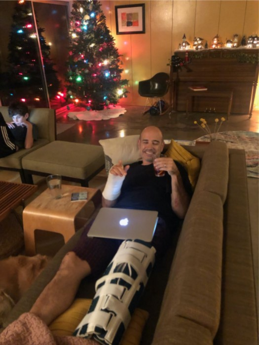 My dad, finally home from the hospital and recovering on our couch.