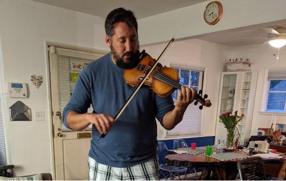 Mr. P. playing his violin.