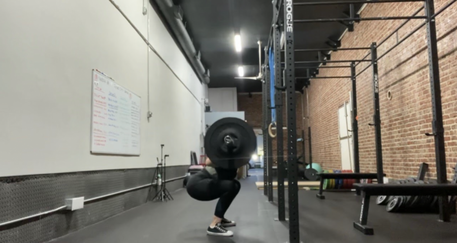 Dockter powerlifting at her gym.
