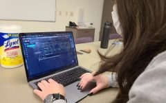 A computer science student works on an assignment.